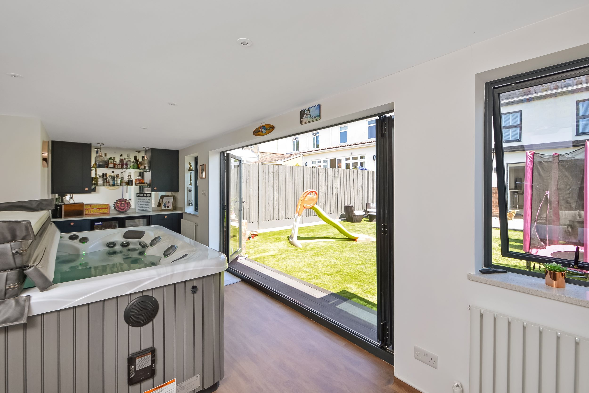 After photo of house renovation and loft conversion with outbuilding and bifold doors in Portsmouth by architect Thorns Young Architectural
