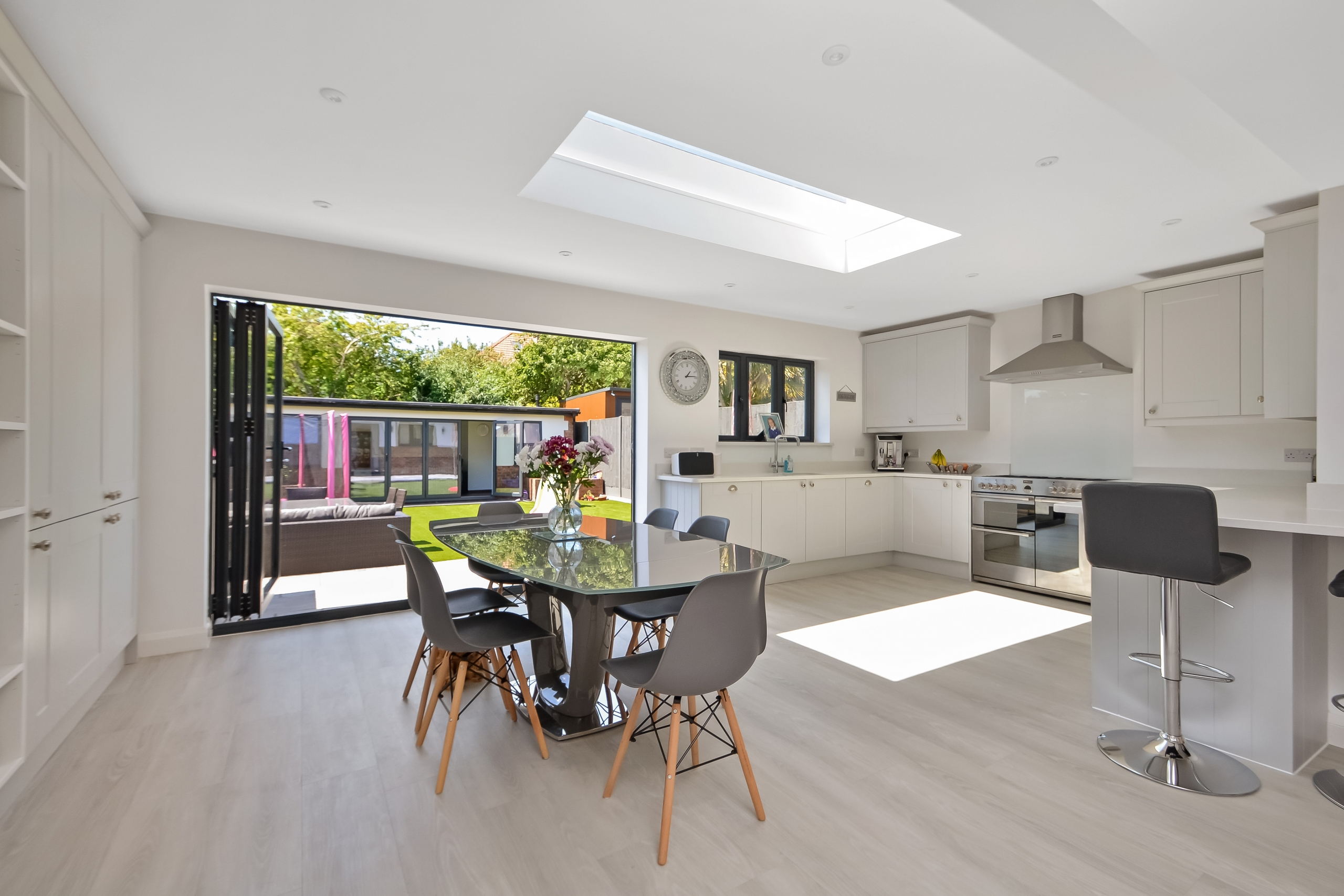 After photo of house renovation and loft conversion with outbuilding and bifold doors in Portsmouth by architectural technologist Thorns Young Architectural